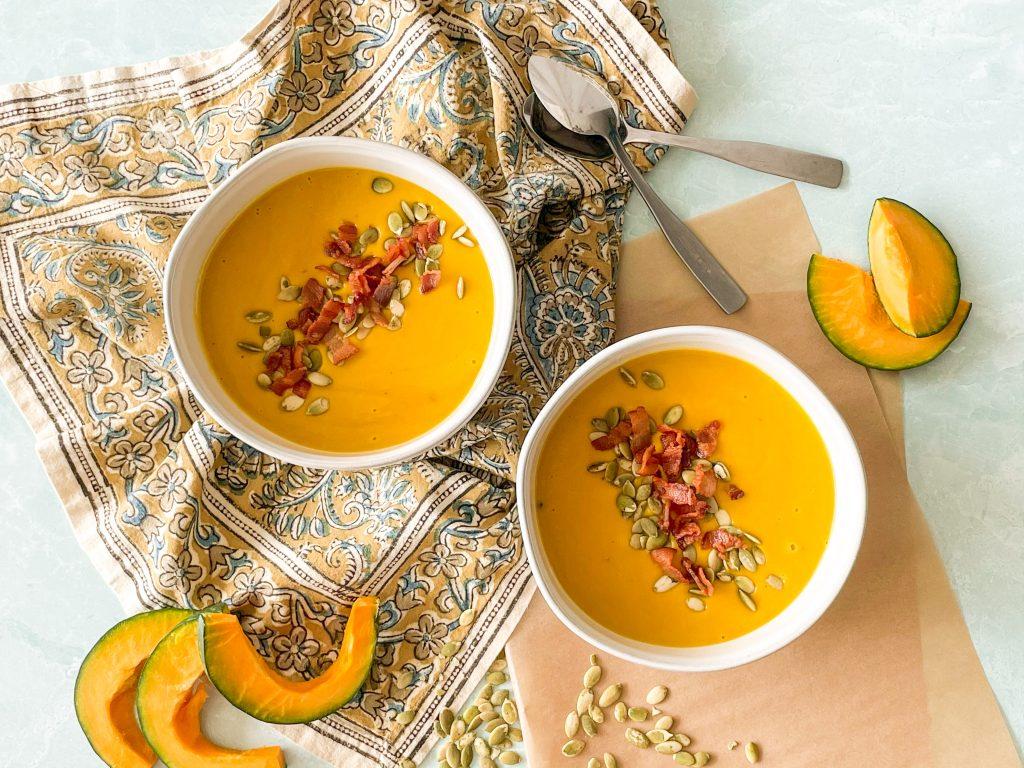 Two bowls of kabocha squash soup