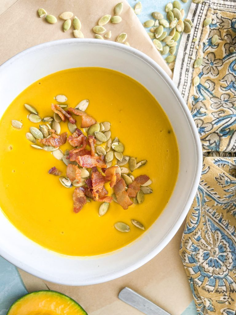 close up photo of kabocha squash soup in bowl